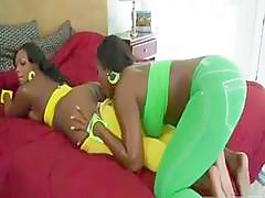 Booty ebony sluts with big boobs stuff their cunts with tongues and...